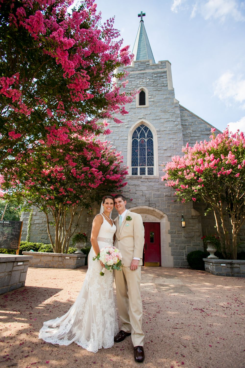 Alex & Michael kiss in front of Incarnation Lutheran Church after their wedding there in Columbia, SC.