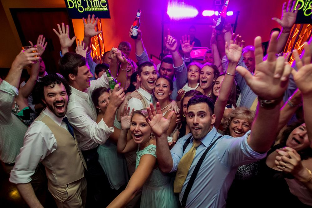 Alex & Michael celebrate with their friends during their wedding reception at Stone River in West Columbia, SC