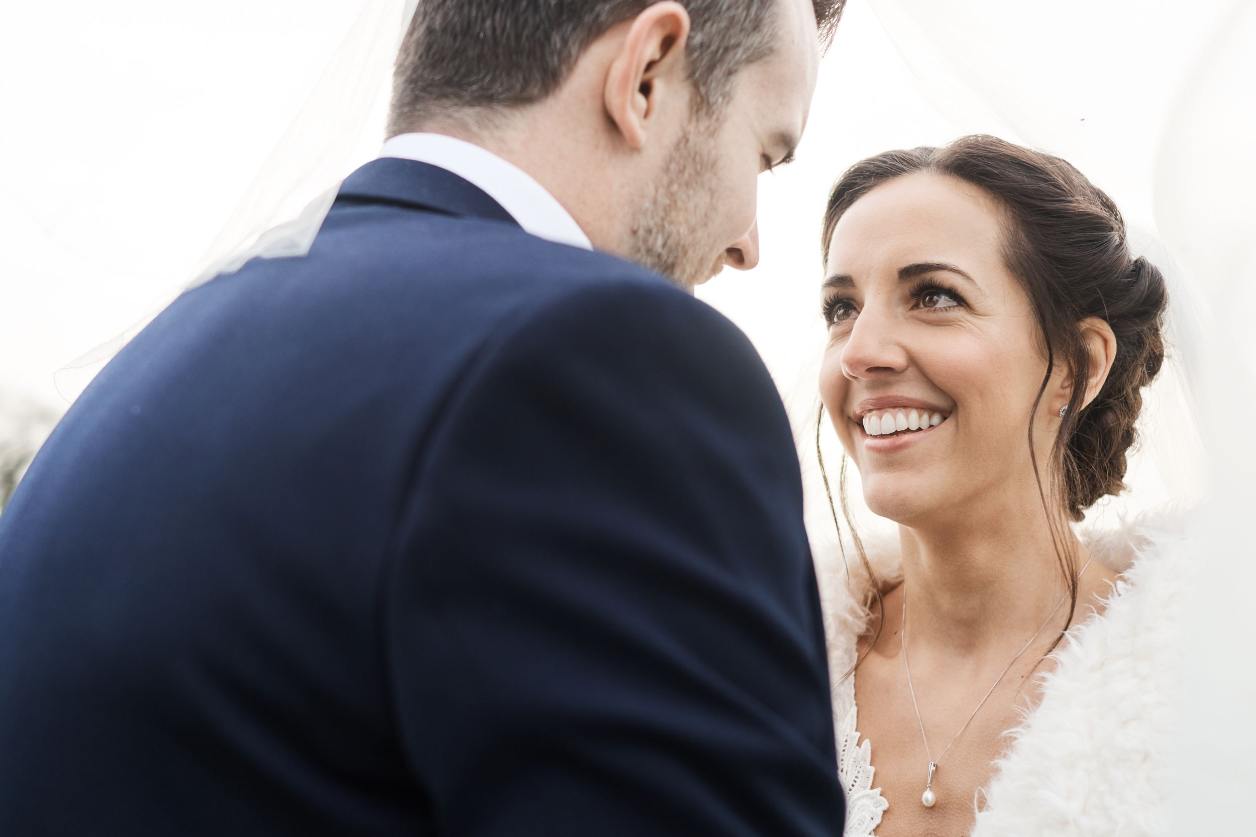 bride smiles at groom during portraits at Southwood in Norfolk. by Norfolk wedding photographer