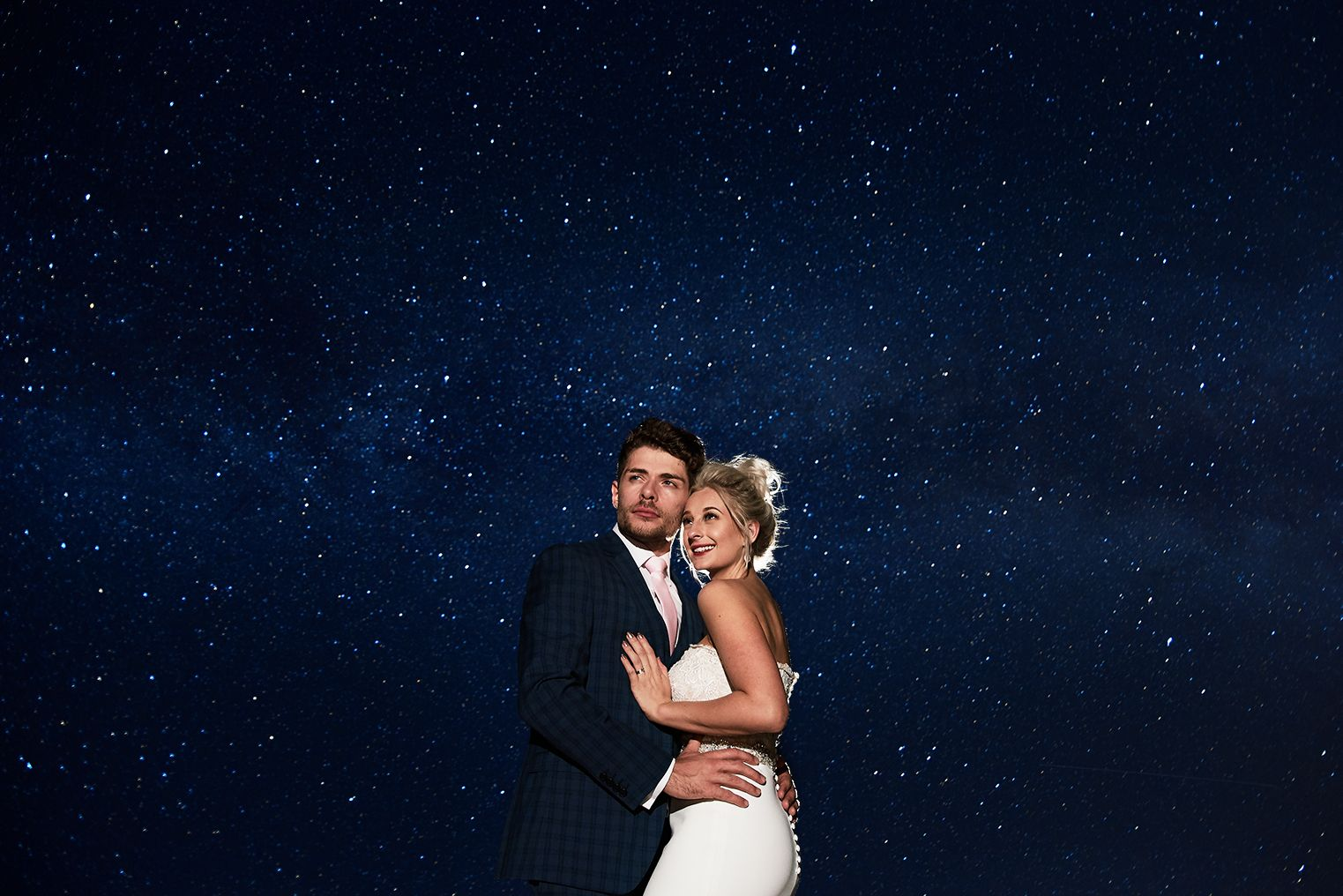 bride and groom stand under the starlit sky for twilight portrait at Bressingham Barn, Suffolk. by Norfolk photographer