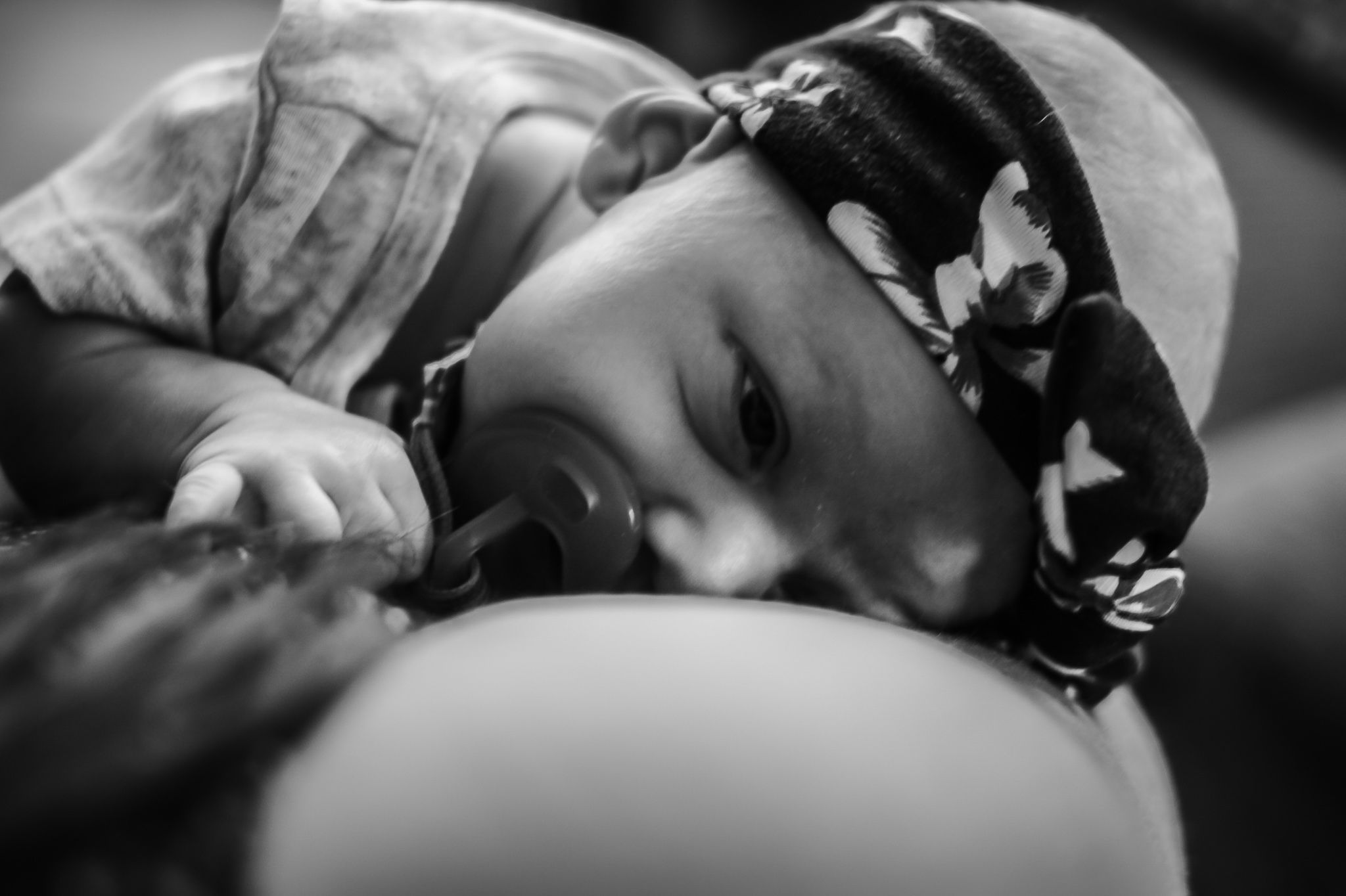 Baby girl snuggling her mom during her in-home newborn session in Sioux City, IA.