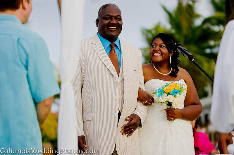 Father walks daughter down the aisle during a beach wedding at Embassy Suites in Dorado, Puerto Rico