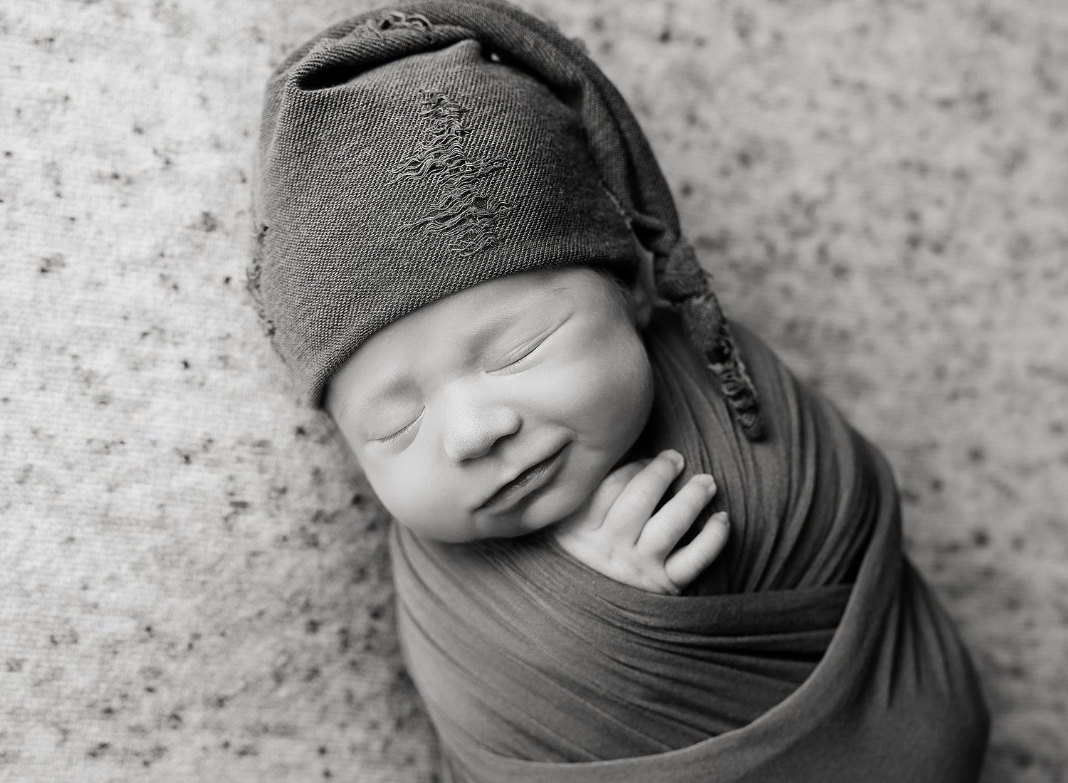 Griffin's Newborn Session with Austin Newborn Photography black and white newborn with sleepy cap grins