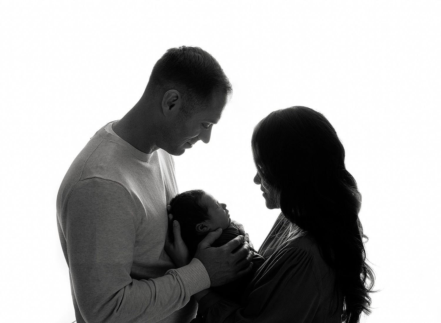 Griffin's Newborn Session with Austin Newborn Photography  family portrait silhoutte