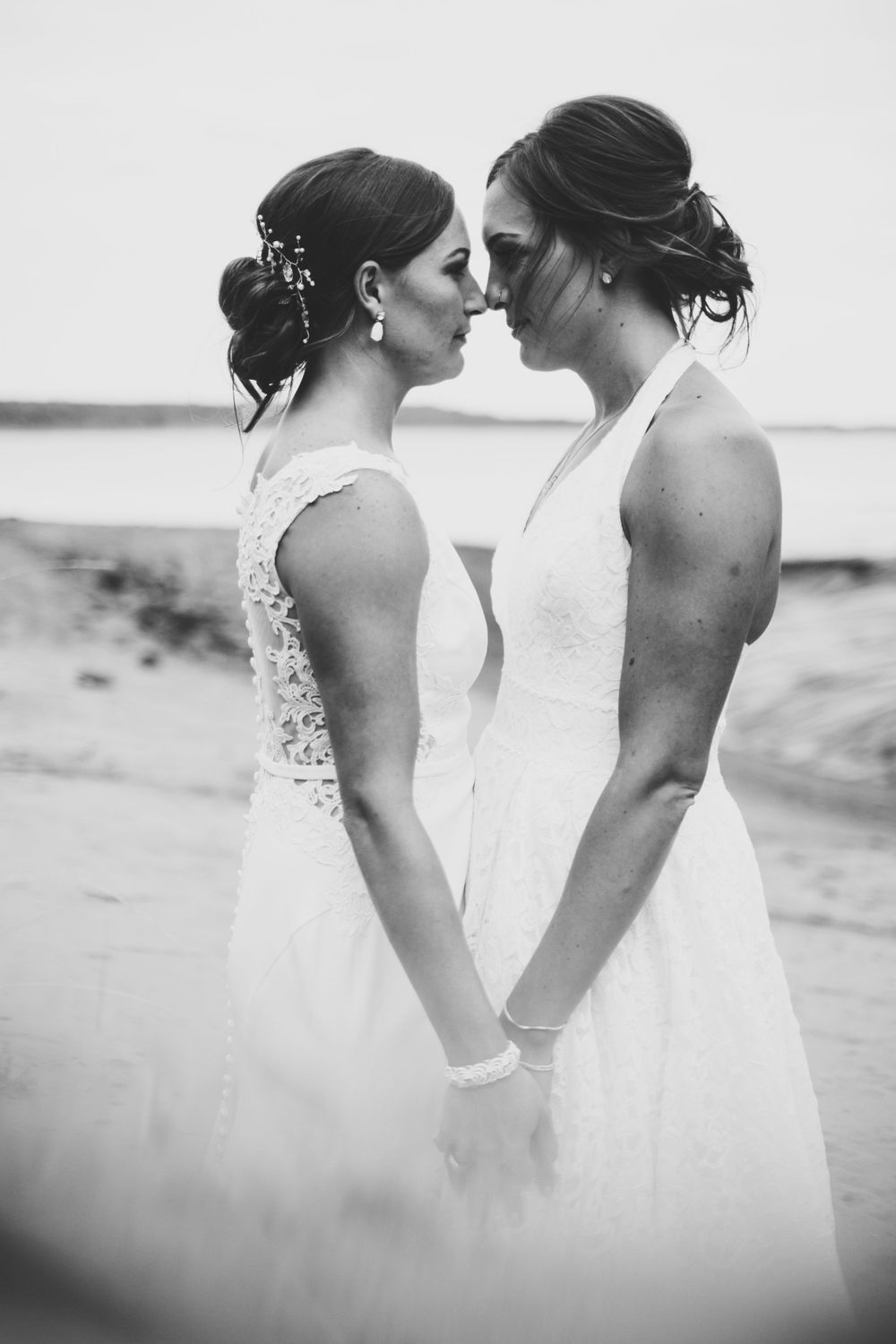 lesbian wedding lgtbq two brides standing facing one another