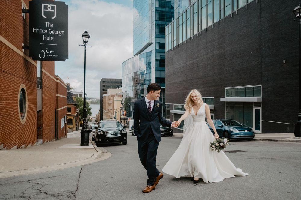 urban wedding prince george halifax couple crossing street