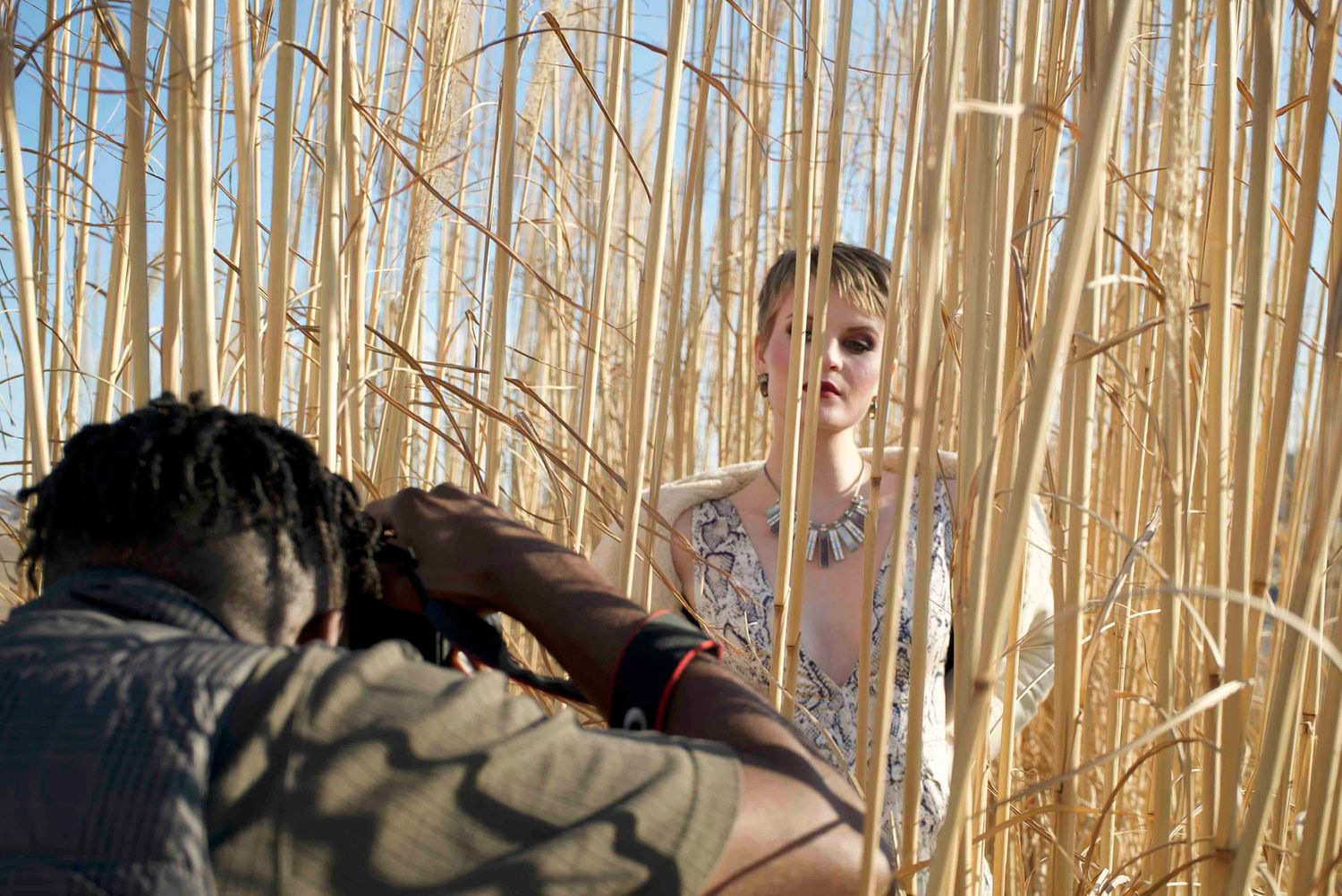 Model Racquel Parson being photographer William Mason in tall grass.