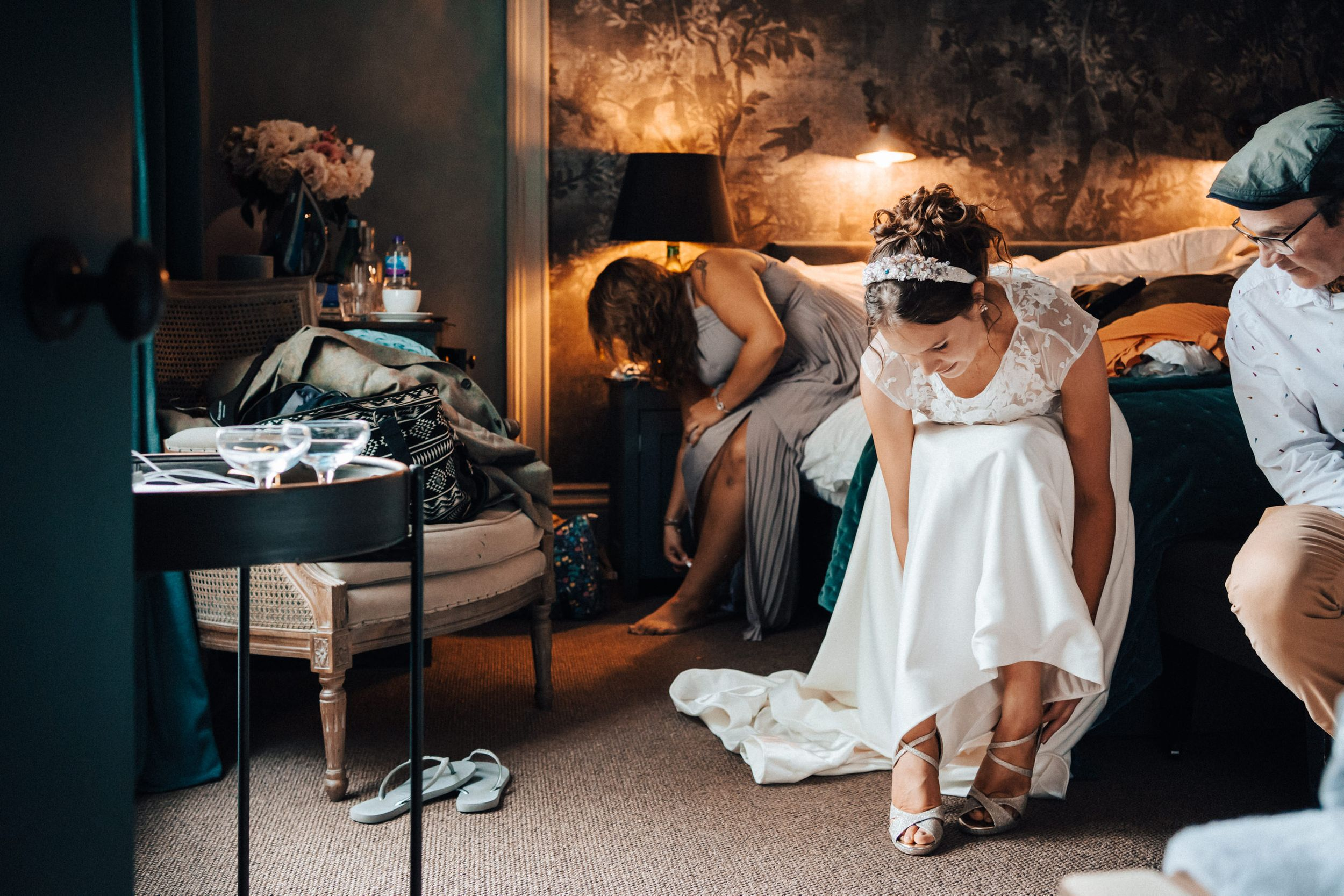 Candid reportage photography Cheltenham bridal prep bride putting her shoes on