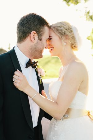 Aaron Snow Photography Oklahoma Wedding Photographer Southwind Hills Bride groom kissing cuddling Erin