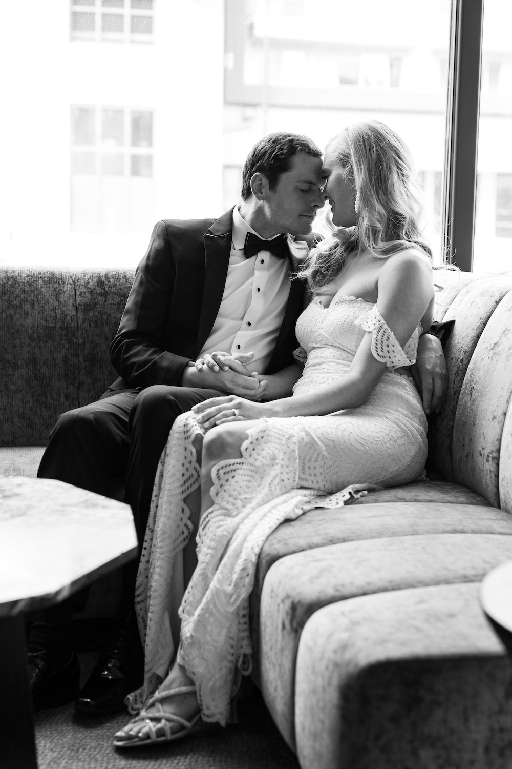 Aaron Snow Photography Oklahoma Wedding Photographer 21C Hotel OKC Bride Groom Kissing Couch lobby Trinian O'Neil Carson