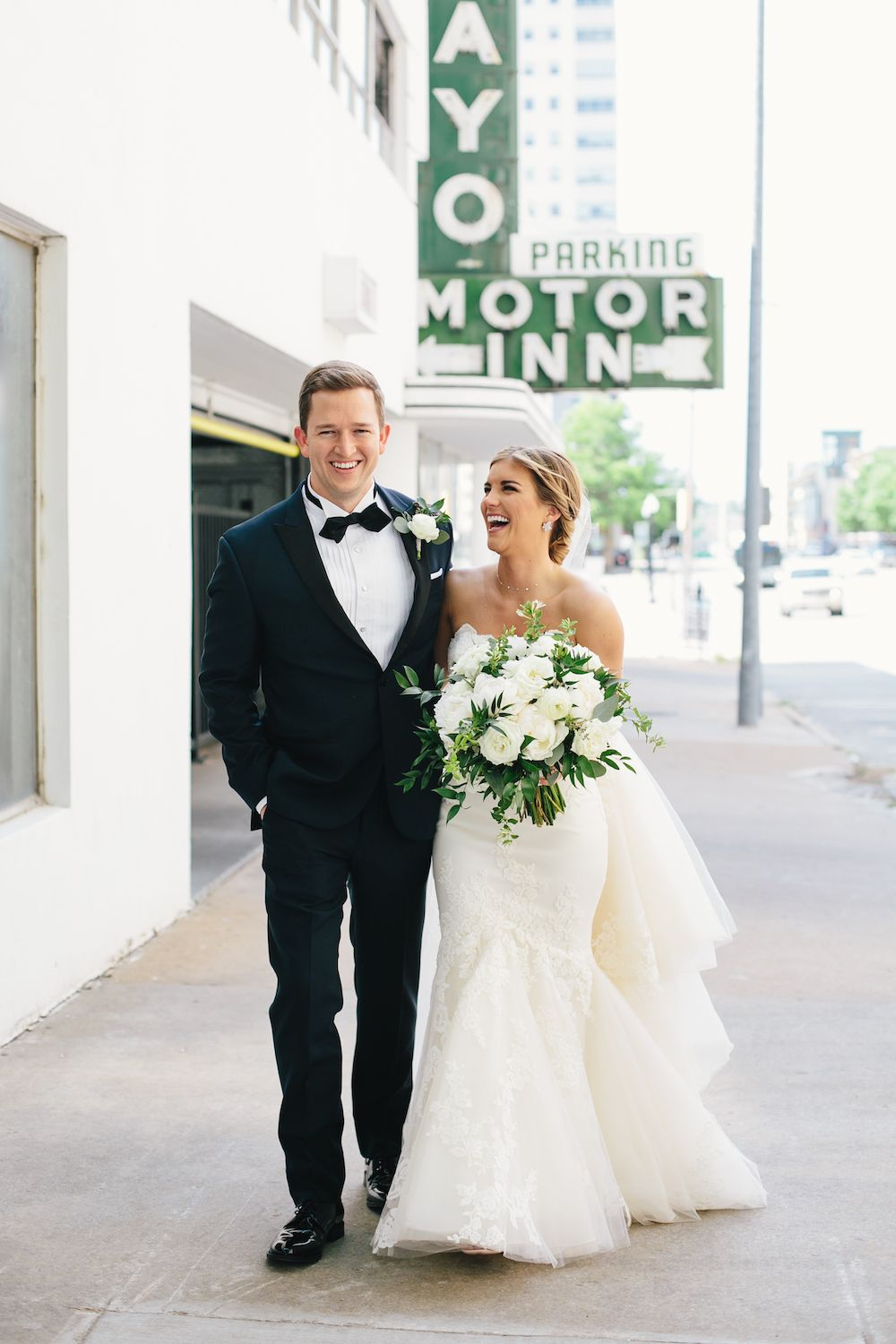 Aaron Snow Photography Oklahoma Wedding Photographer Tulsa Mayo Hotel Motor Inn Sign Bride Groom bouquet Wackenhuth