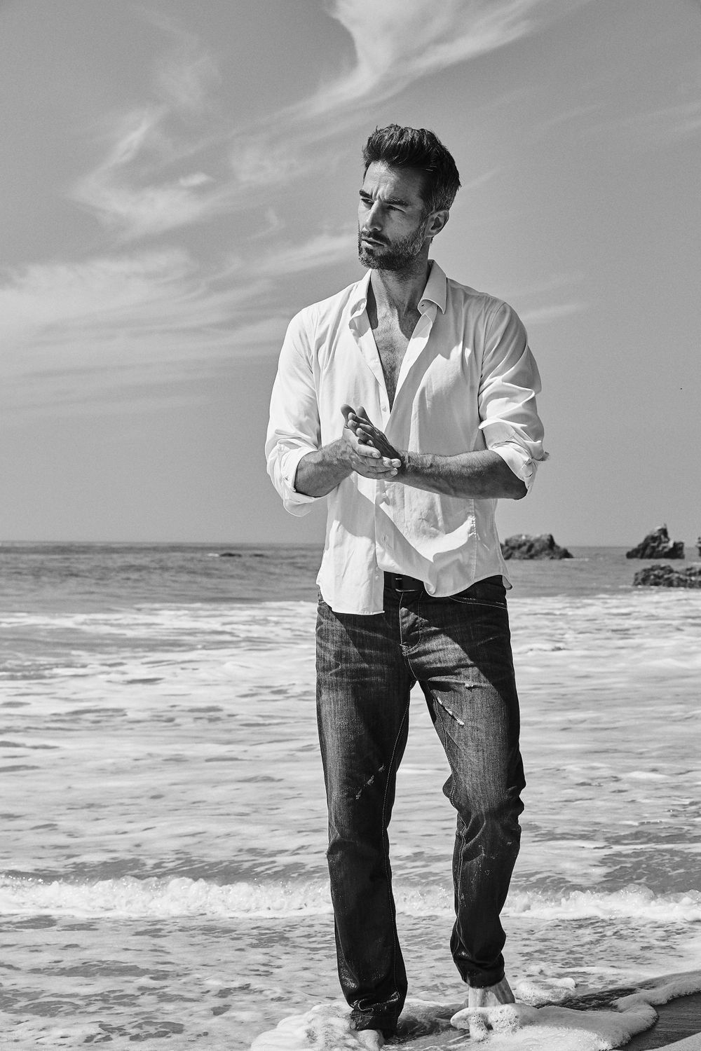 Model Colin Devitt from LA Models wearing denim jeans and white buttoned shirt El Matador State Beach