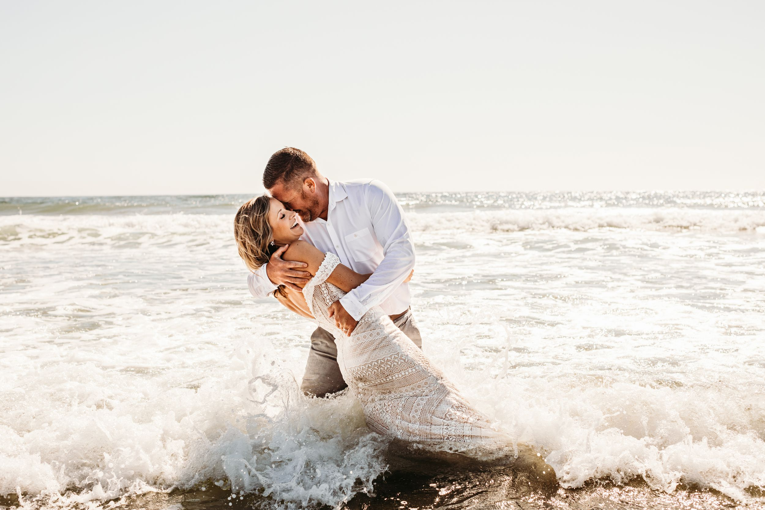 Central Coast, California elopement couple in the ocean waves.