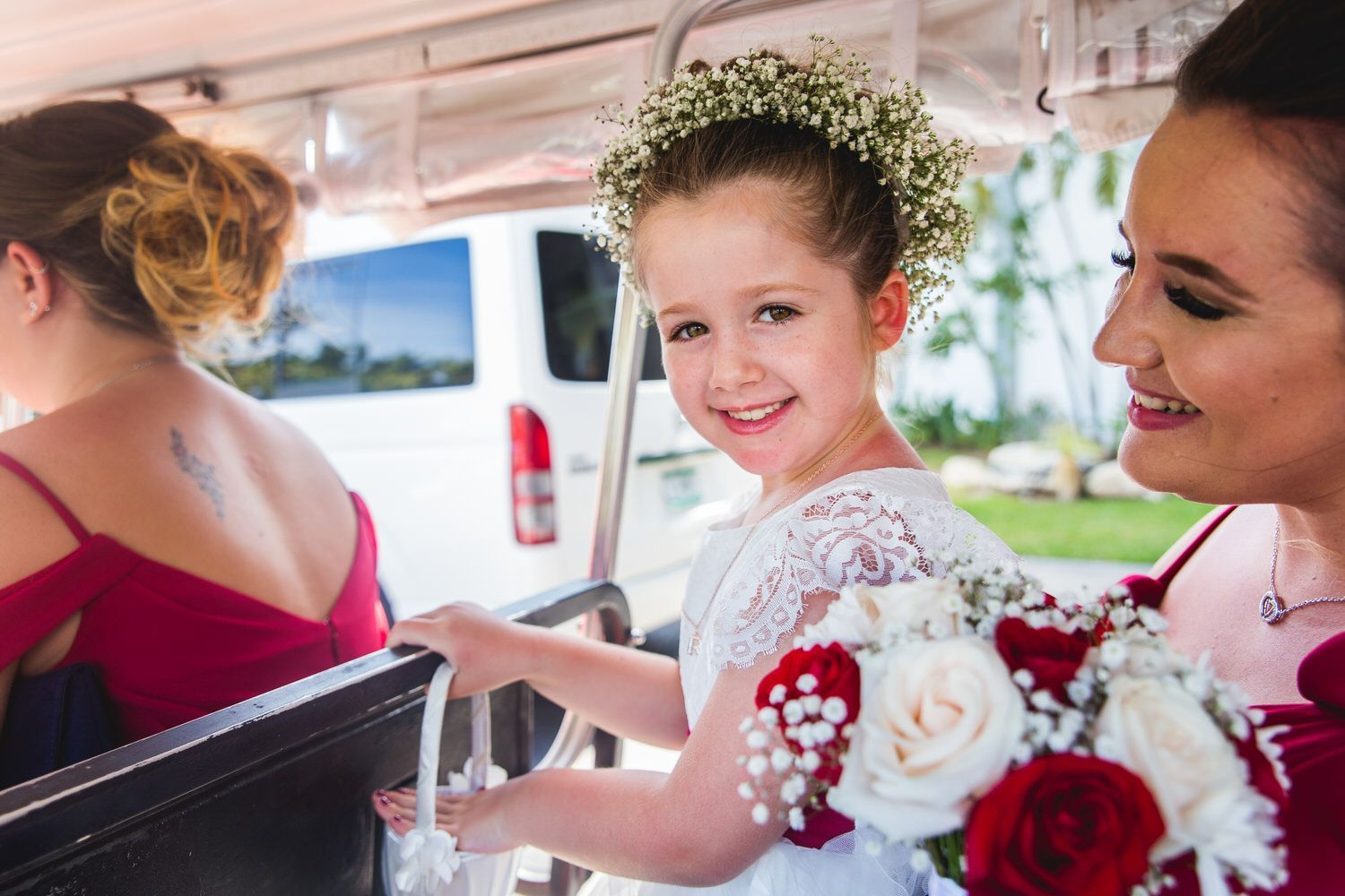 girl at wedding in Mexico on golf cart