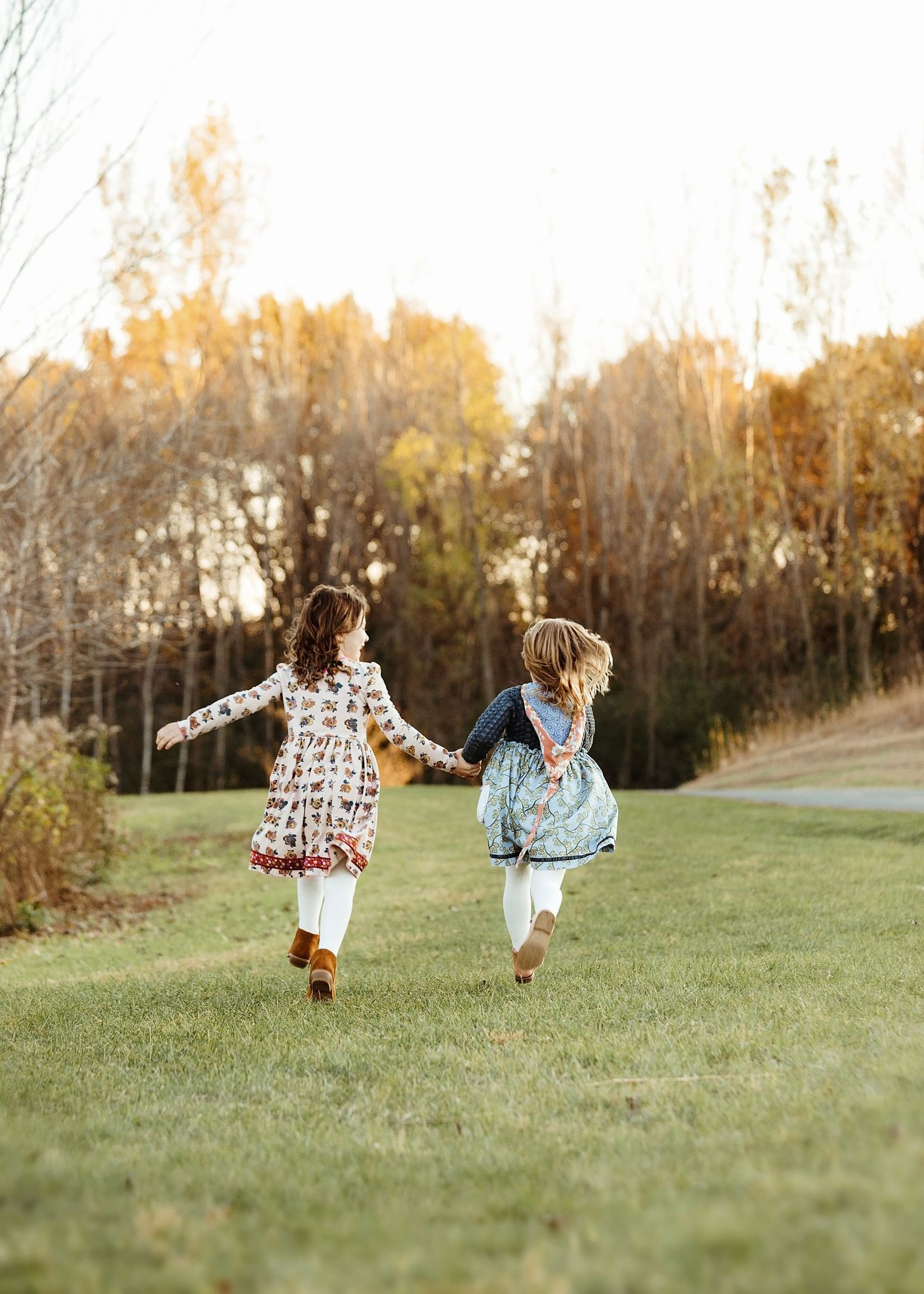 sisters running in a field