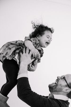 Black and white photo of dad and daughter