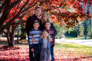 Family photo session in the fall with colored leaves