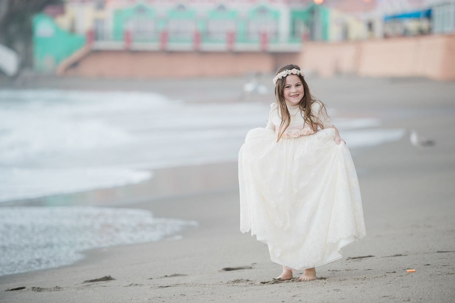 Communion girl in Caleta Beach smiling at the camera