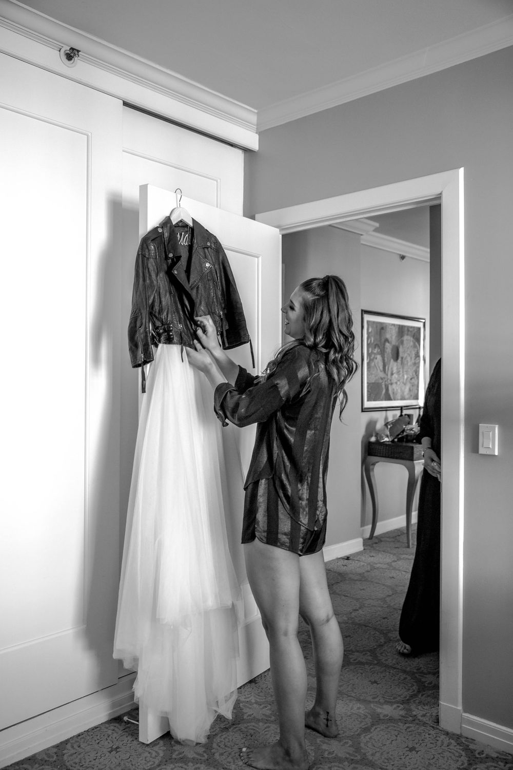 rebecca skidgel photography marina academy san francisco wedding bride admiring her wedding dress