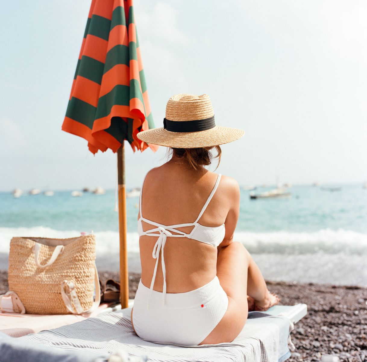 Aaron Snow Photography Italy Wedding Photographer Positano Beach Hasselblad Camera Girl Sunhat Umbrella White Bikini