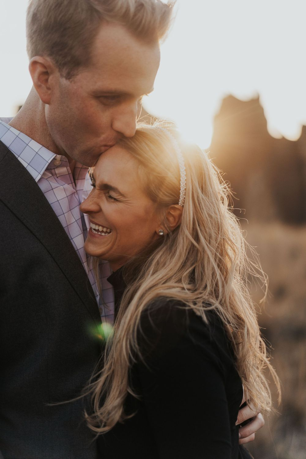 Photo by Kelsie Burke Photography of the couple snuggling and laughing together at Smith Rock State Park