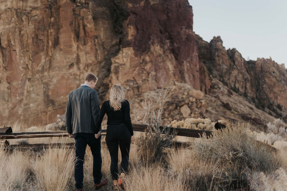 Photo by Kelsie Burke Photography of the couple walking hand in hand at Smith Rock State Park