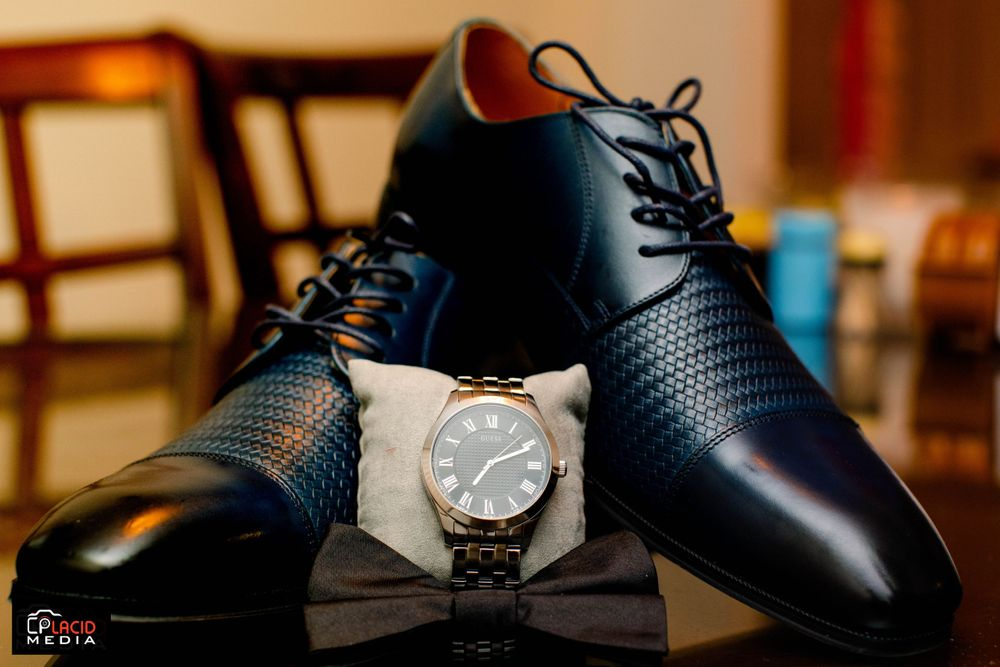 Groom shoe details with watch photograph