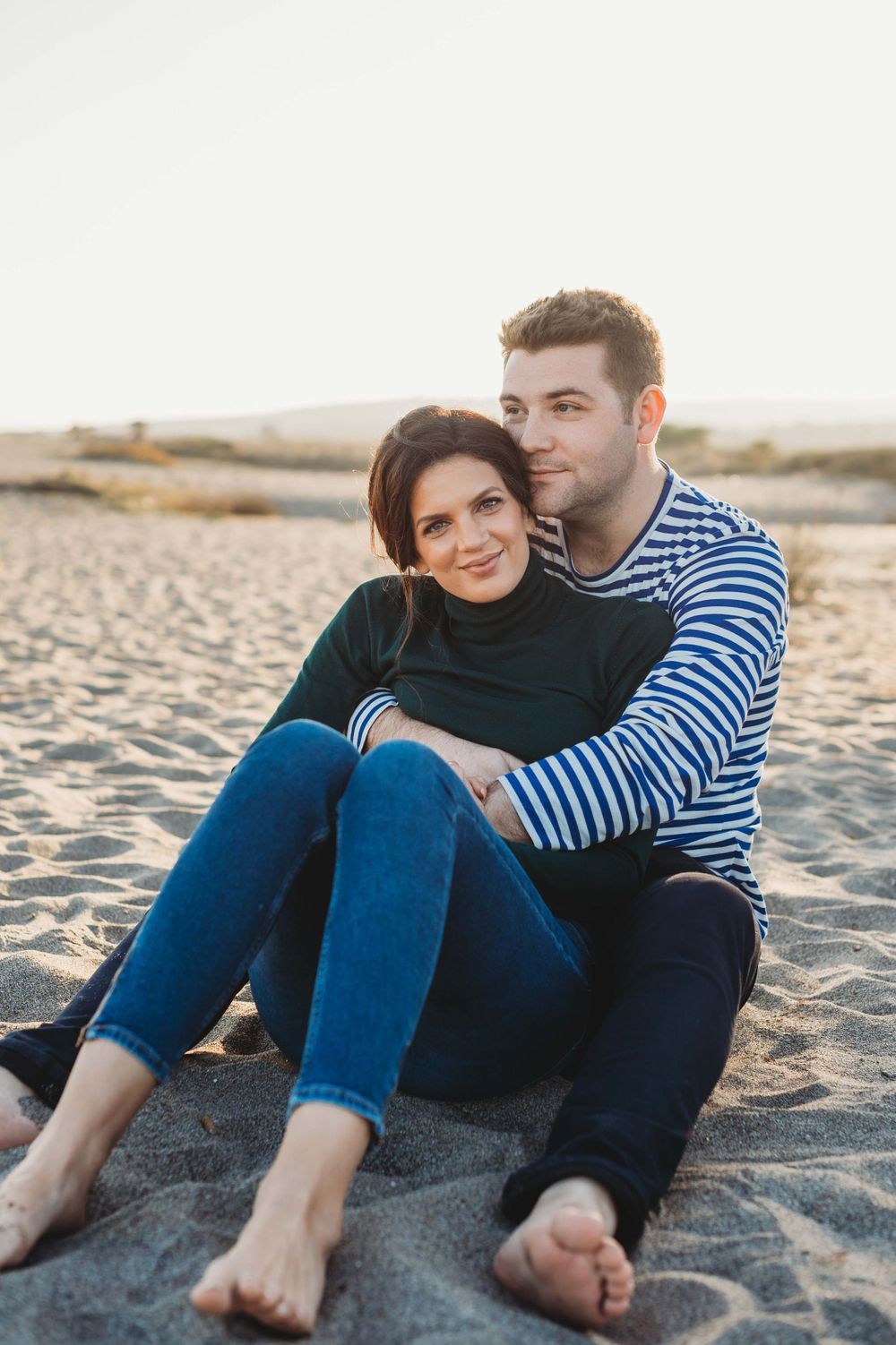 Portrait of a couple smiling on a beach
