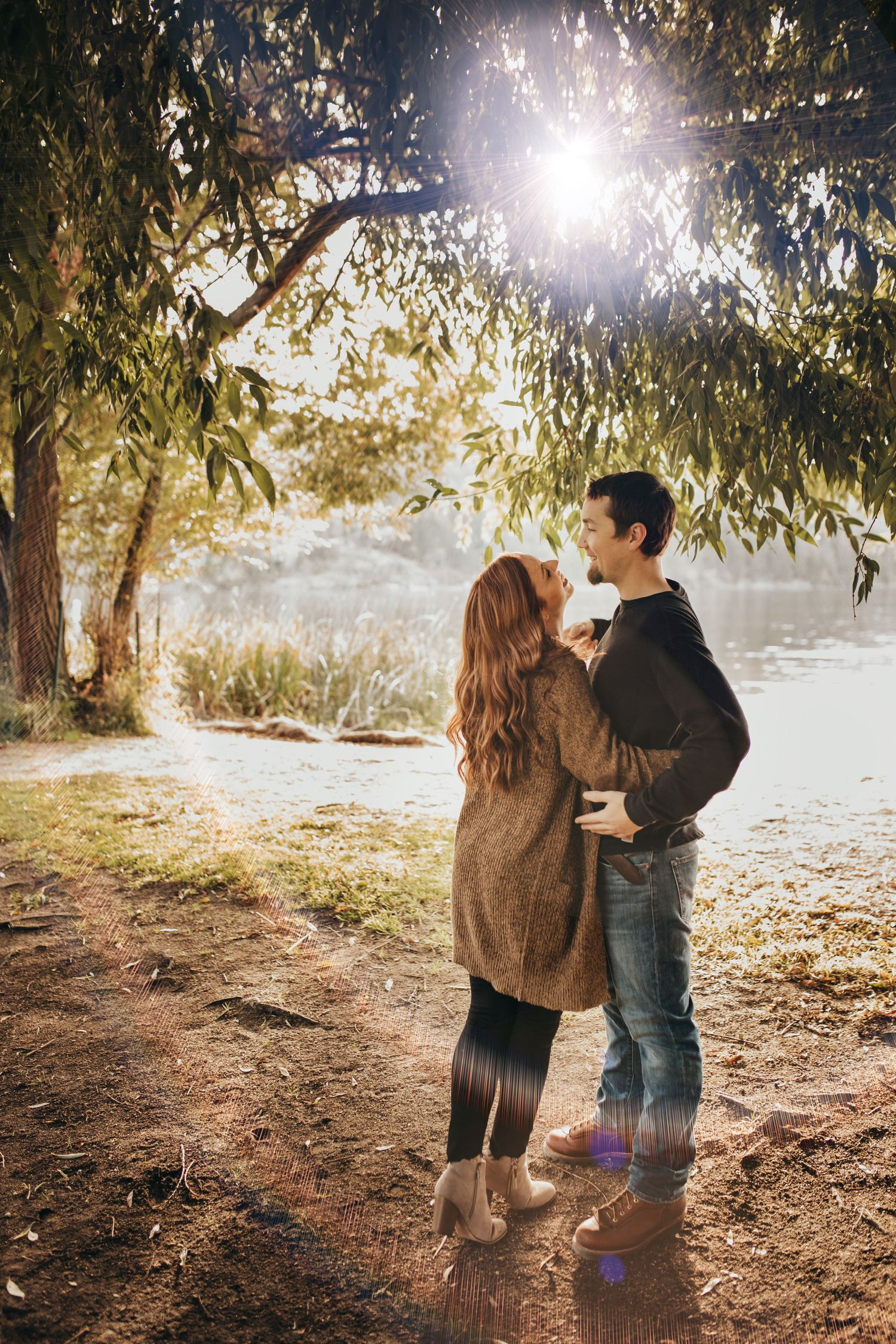 sun flair fall sunset engagement photos liberty lake large tree Soulful Hues Photography