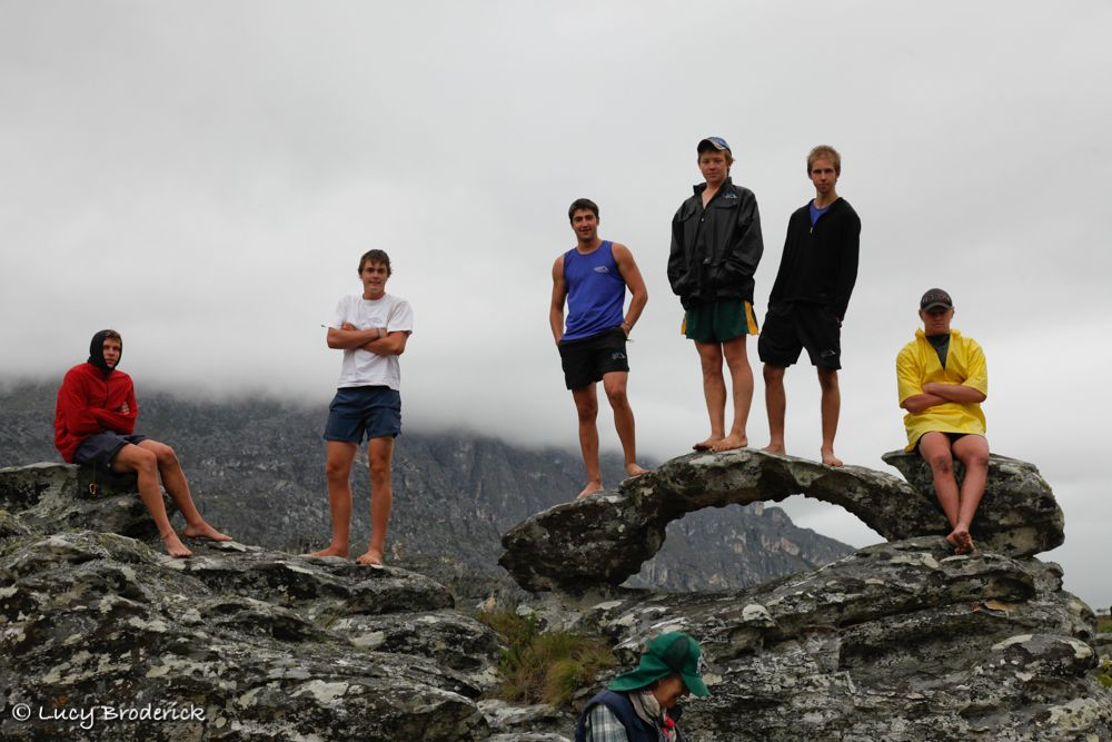 Boys standing on an interesting rock in Chimanimani Mountains, Zimbabwe on the Ironwill Charity Eco Challenge.