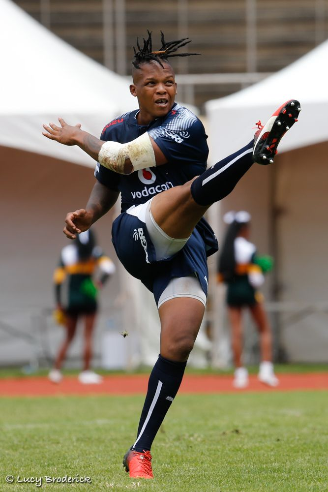 A Vodacom Bulls rugby player warms up by kicking the ball at the National Sports Stadium, Harare, Zimbabwe.