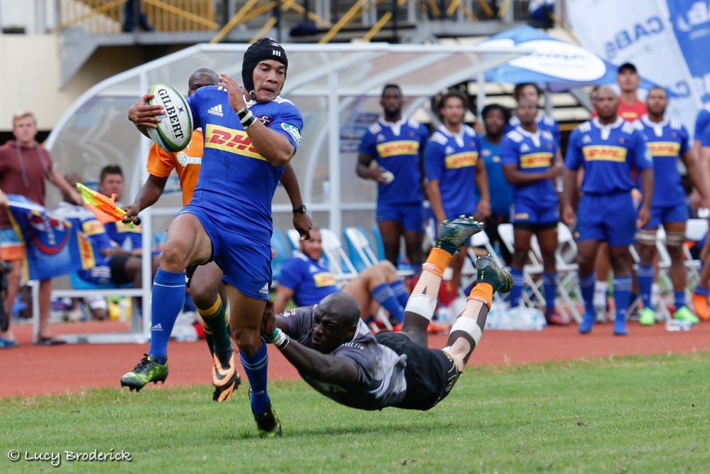 DHL Stormers Rugby Player Cheslin Kolbe escapes a tackle from a Toyota Cheetah's player in Harare, Zimbabwe.