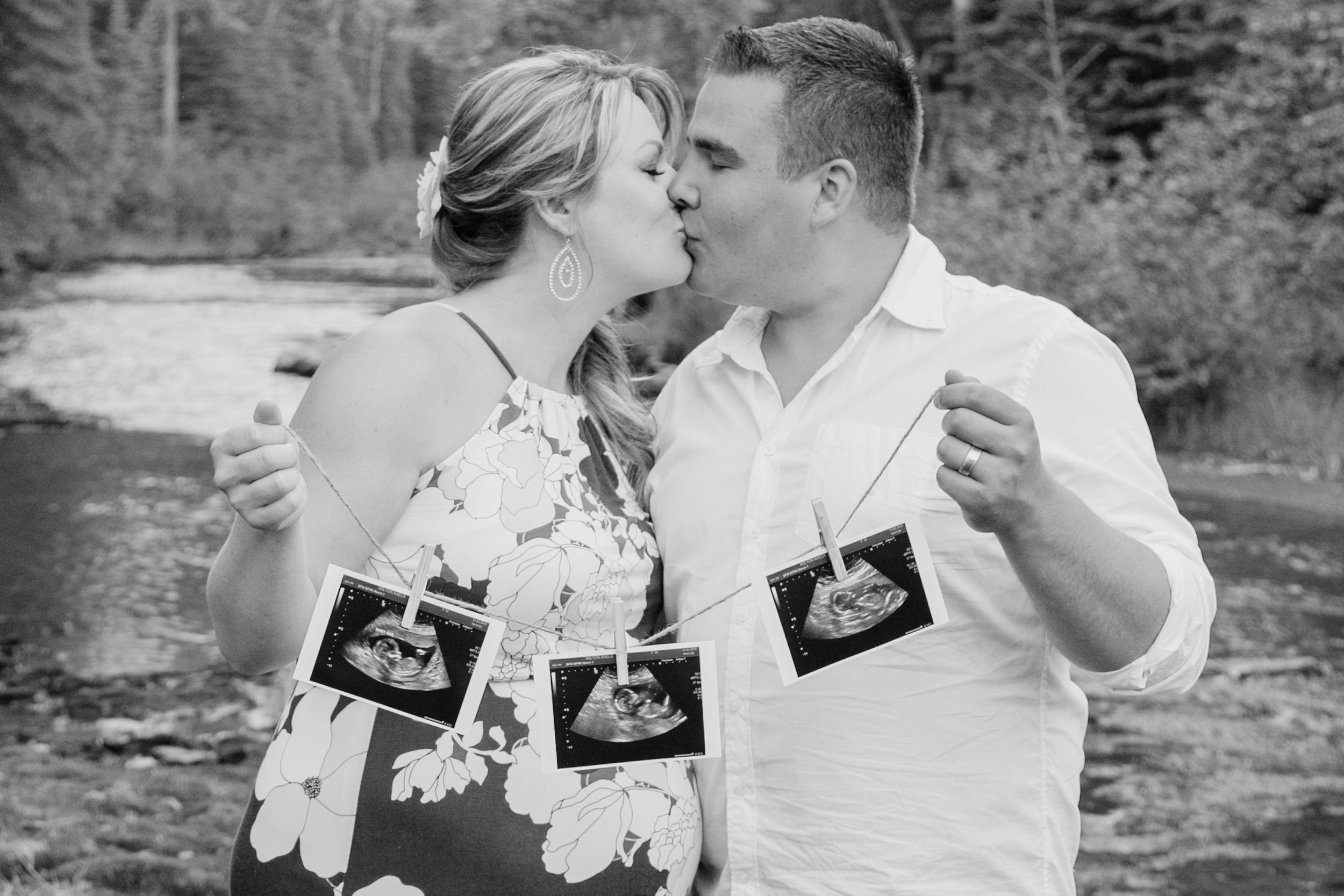 Couple expecting triplets hold 3 ultrasound pictures
