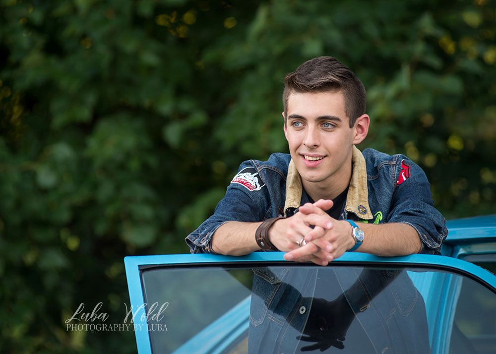 high school senior boy with his blue car taken in Coeur d'Alene by Photography By Luba lifestyle casual