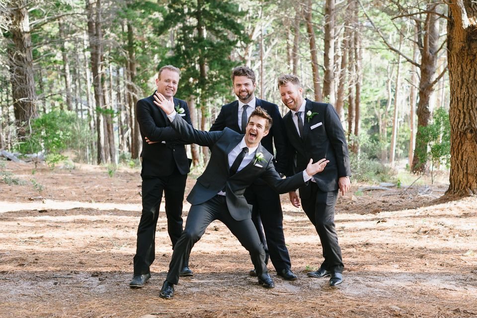 Groom and Groomsmen being silly in the forest at their Santa Cruz Wedding