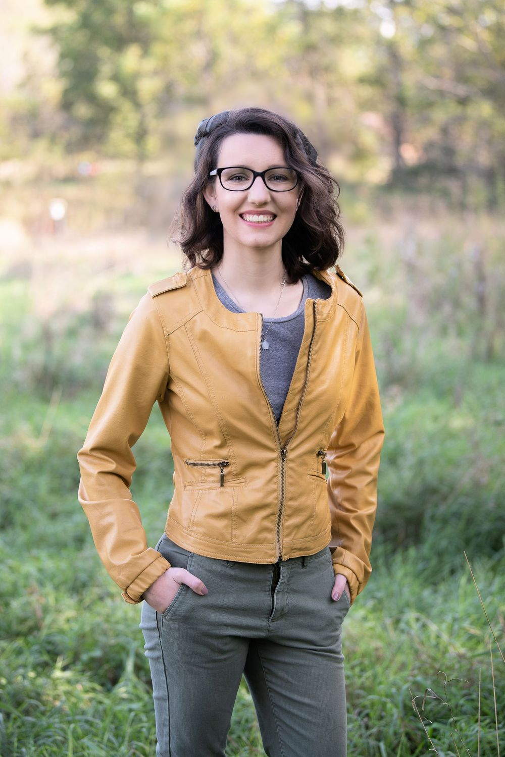 glasses, senior girl, yellow jacket, mustard color