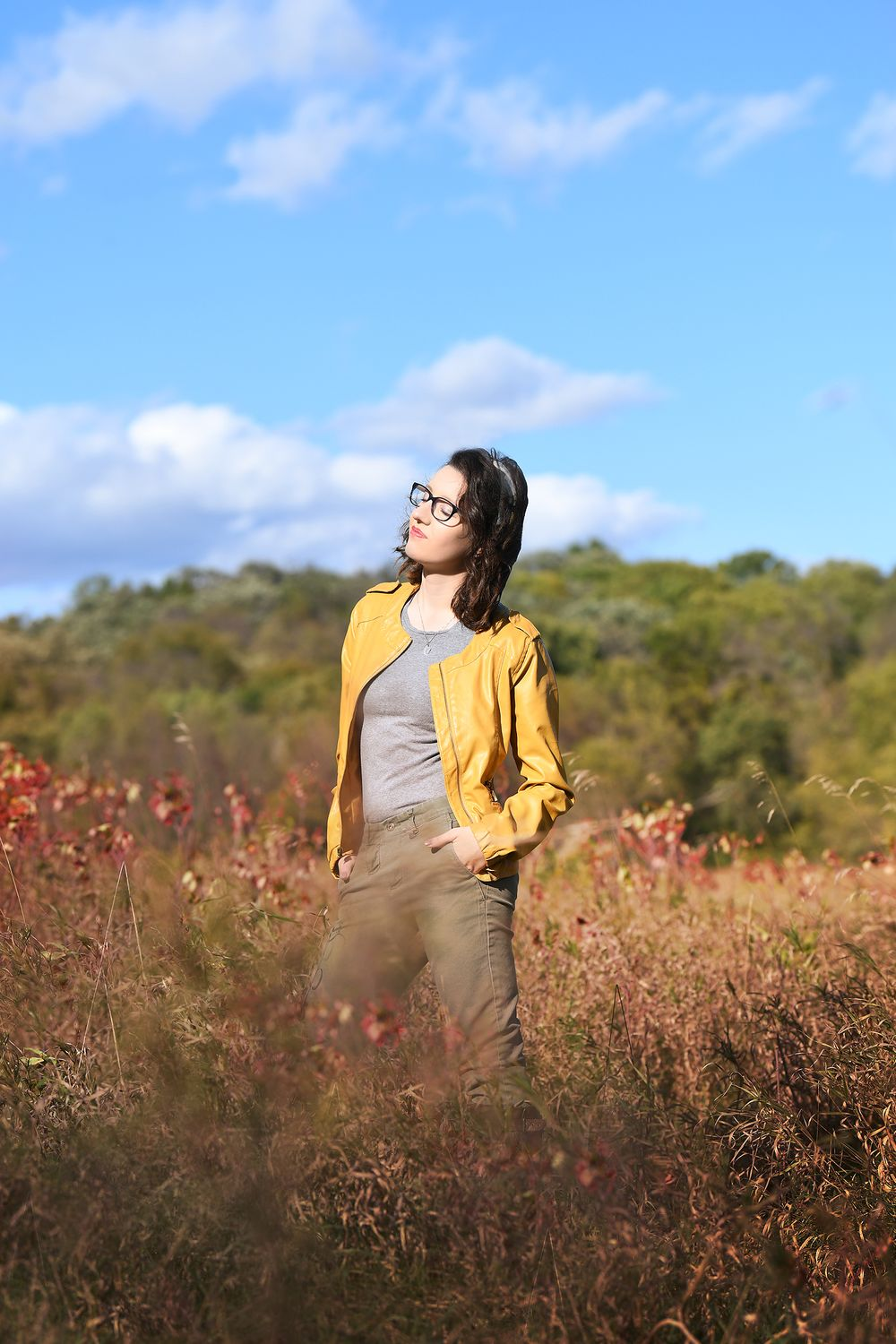 Mustard yellow pleather jacket, blue skies, senior session