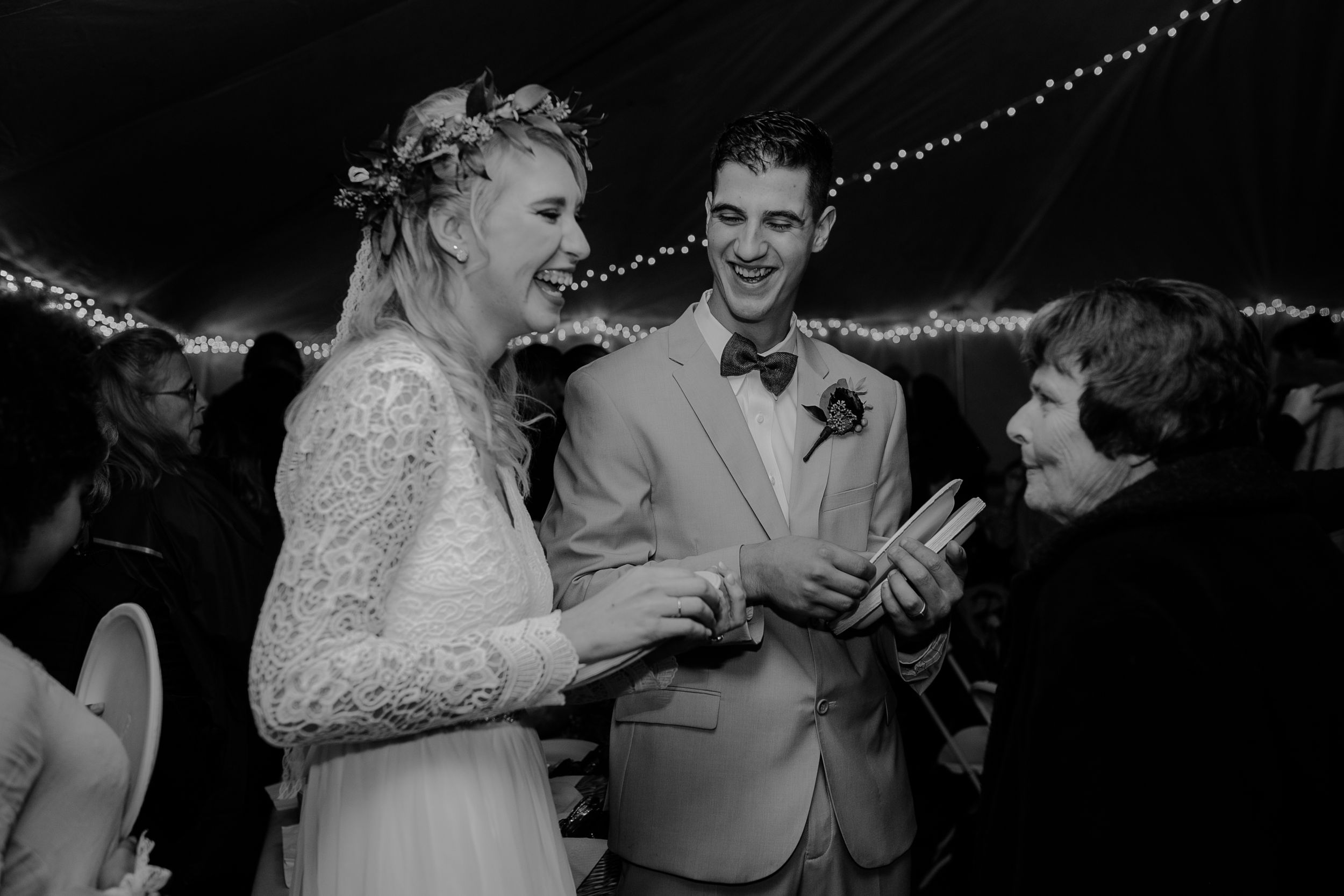 bride-groom-passing-out-food-at-reception-in-tent-backyard-wedding-raelyn-ramey-photography