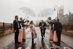 bride-groom-riding-scooters-through-wedding-party-minneapolis-minnesota-raelyn-ramey-photography