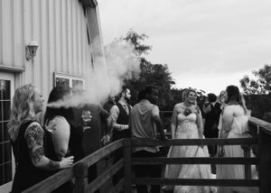 bride-standing-outside-at-summerset-winery-talking-with-friends-indianola-iowa-raelyn-ramey-photography