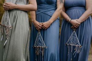 bridesmaids-holding-dreamcatchers-grand-lake-colorado-raelyn-ramey-photography