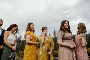 bridesmaids-laughing-during-intimate-ceremony-elopement-grand-lake-colorado--raelyn-ramey-photography