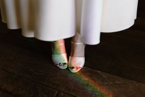 bride-shoes-with-a-reflected-rainbow-republic-on-grand-desmoines-iowa-raelyn-ramey-photography