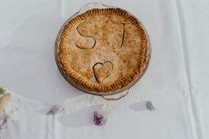 pie-with-letters-carved-in-it-double-a-barn-grand-lake-colorado-raelyn-ramey-photography