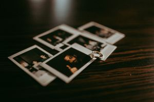 detail-shot-of-wedding-ring-on-polaroids-des-moines-iowa-raelyn-ramey-photography