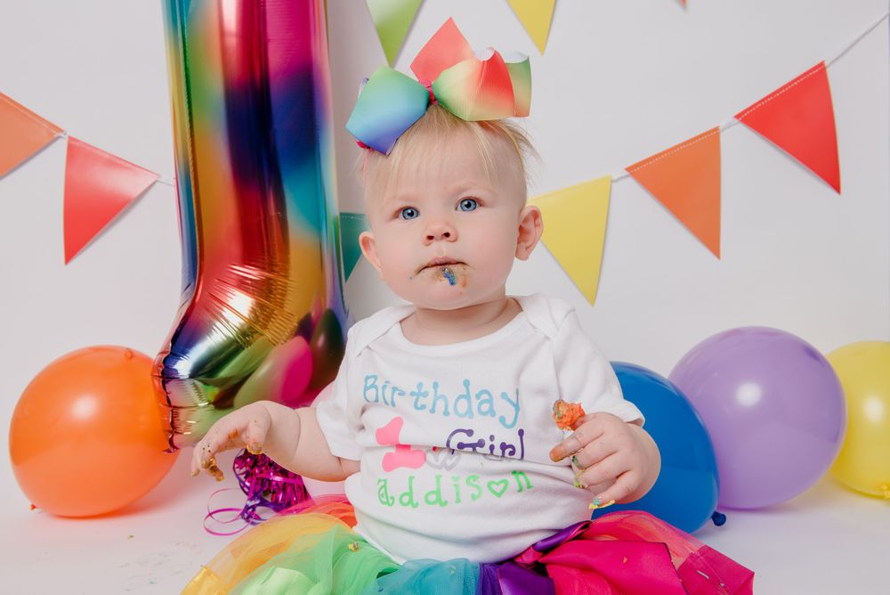 one year old girl rainbow cake smash session
