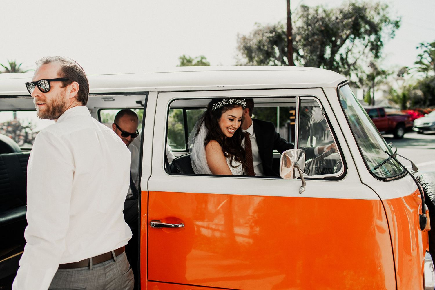 bridal party getting inside volkswagon van