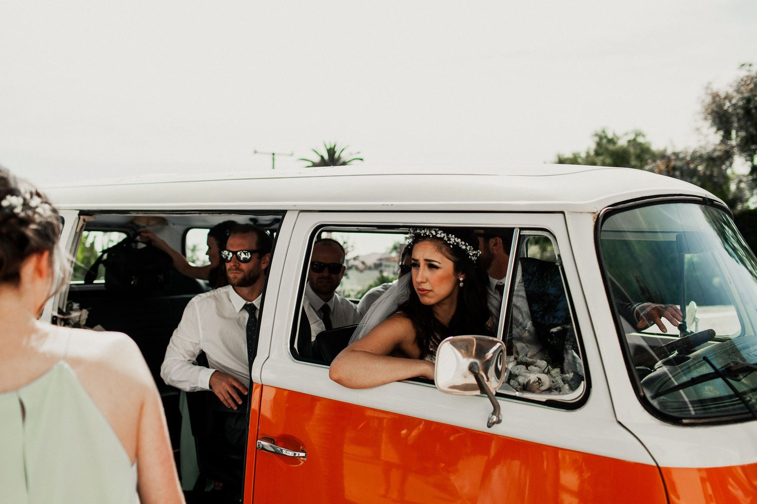 bride looking outside window of volkswagon van