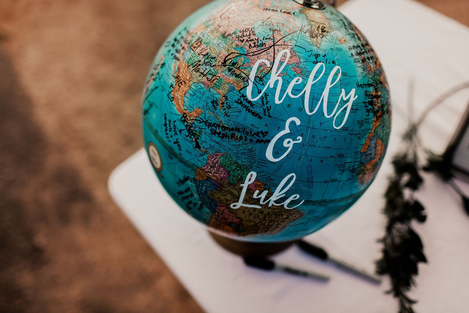 chelly and luke globe sign in at reception decor