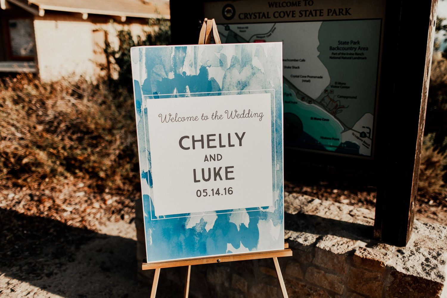 entrance sign at crystal cove wedding